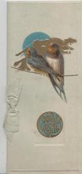 GOOD WISHES (illuminated in circle) below 2 bluebirds of happiness perched on a rope in front of gilt cloud & blue sun