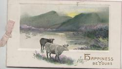 HAPPINESS BE YOURS in gilt below inset of hills, heather & lochs, behind 2 cows in water moving right