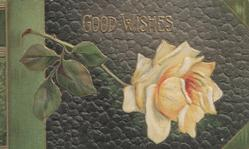 GOOD WISHES in gilt above orange rose, faux leather grey background