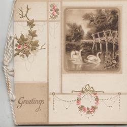 GREETINGS below left,  watery rural inset , 2 swans swim, bridge right, all set in floral design