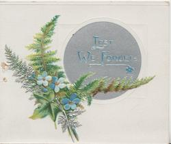 LEST WE FORGET in blue on circular silver plaque, fern, ivy & forget-me-nots below left