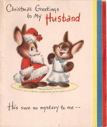 CHRISTMAS GREETINGS TO MY HUSBAND rabbit dressed as Santa left, another rabbit right HE'S SURE NO MYSTERY TO ME