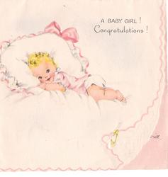 A BABY GIRL! CONGRATULATIONS! baby lies on pillow & looks forward, diaper pin lower right