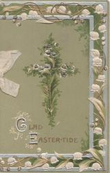 GLAD EASTER-TIDE (illuminated) in gilt below glittered fern covered cross, ornate lily-of-the valley marginal design, green background