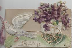 GREETINGS in gilt below purple violets in card pulled by pidgeon, applique to adherent front cover