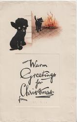 WARM GREETINGS FOR CHRISTMAS FROM, black poodle puppy left, black cat stands by blazing fire