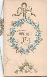 WISHES TRUE inside of wreath of forget-me-nots, ivy at bottom