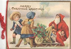 MERRY CHRISTMAS GREETINGS in gilt, boy & girl in front of red coated santa with sled & toys, berried holly