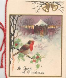 A SONG OF CHRISTMAS in blue below robin perched on holly, snowy rural scene, lighted church, evening, 2 gilt bells above