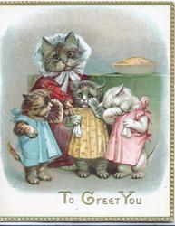 TO GREET YOU below cat & 3 kittens standing dressed as people below pie on shelf
