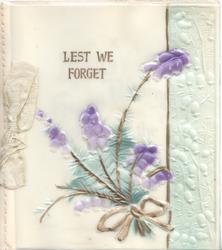 on celluloid front, LEST WE FORGET in gilt above purple heather