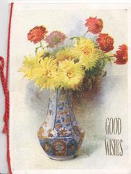 GOOD WISHES in gilt beside vase of yellow & red chrysanthemums