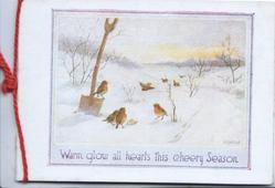 WARM GLOW ALL HEARTS THIS CHEERY SEASON, English robins in snow, one perched on spade