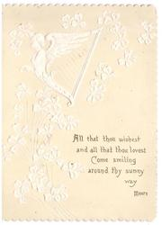 ALL THAT THOU WISHEST ... in gilt below white embossed angel bust harp with cascading clovers on yellow