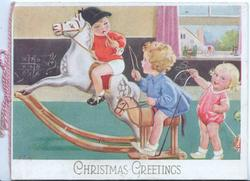 CHRISTMAS GREETING three children play, 2 on wooden horses