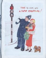TIME TO WISH YOU A HAPPY CHRISTMAS! caricature of policeman & woman carrying holly & presents, stop lights left, tiny dog right