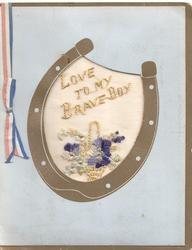 LOVE TO MY BRAVE BOY above basket of pansies embroidered in gilt on thin mesh in gilt horseshoe