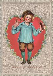 VALENTINE GREETING, FRITZ, boy stands dressed in blue & brown holding up pretzel & sausage