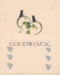 GOOD LUCK in gilt below 2 tiny black cats sitting on rings & clover