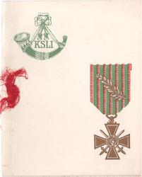 KLSI (King's Shropshire Light Infantry) badge in green upper left, gilded military war cross of France lower right