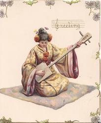 GREETING in gilt as musical notation written above seated Japanese girl in yellow Kimono kneeling on mat holding musical instrument