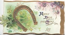 HAPPY DAYS AND MANY(H, D & M illuminated) on white plaque, gilt horseshoe & ivy left & green background, violets top rightT