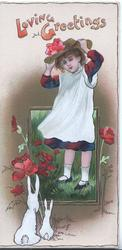 LOVING GREETINGS in orange above girl  standing on grass adjusting her hat  above poppies, watched by 2 white rabbits