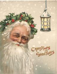 CHRISTMAS GREETINGS in gilt below  hanging lantern at  right, head of Santa with white beard & circlet of holly left