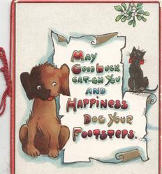 MAY GOOD LUCK CAT-CH YOU AND HAPPINESS DOG YOUR FOOTSTEPS ON WHITE SCROLL. puppy sits left, black cat right, mistletoe above
