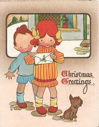 CHRISTMAS GREETINGS(C &G illuminated) boy stands behind girl holding Christmas greeting, puppy front right