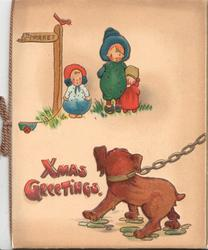 XMAS GREETINGS in pink below 3 children waiting under TO MARKET signpost frightened by chained dog