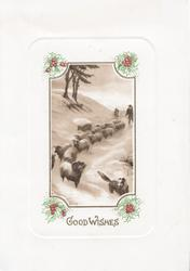 GOOD WISHES inset of sheep led down snowy hill by sheep-dog, shepherd behind, trees back/left, holly at corners