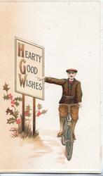 HEARTY GOOD WISHES(H, G & W illuminated), man cycles front pointing to sign board