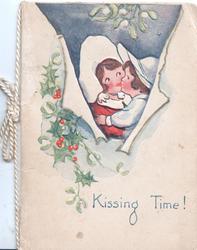 KISSING TIME! boy & girl kiss under mistletoe, berried holly left