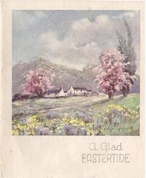 A GLAD EASTERIDE residence between blossoming trees, mountains behind, wild spring flowers in grassy meadow front