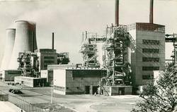 THE WORLD'S FIRST FULL SIZE ATOMIC POWER STATION, POWER STATION 'A' WHICH IS THE FIRST PART OF THE PROJECT COMPLETED AND FEEDING ELECTRICITY INTO THE NATIONAL GRID. MAY, 1958