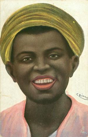 head and shoulders of black woman wearing turban, pink shirt