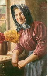 """DIE DORFSCHONEN"" 3/4 study of peasant woman standing by window, vase of flowers on sill"