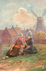 ALLER ANFANG IST SCHWER  two girls sit on grass, buildings & windmill behind