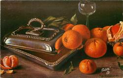 orange in brass dish, others beside with peel, & peeled slices, wine glass behind
