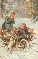 """JOLLY WILL AUCH ETWAS""  girl blows on hands behind barrow of sticks, baby sitting on front feeding terrier"
