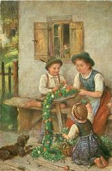 """VOR DEM HOHEN FESTE""  three children work on floral evergreen decoration, dog observes"