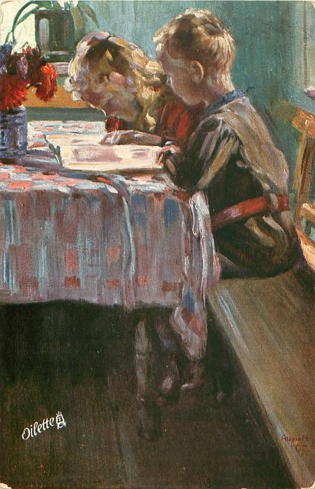 two children sit at table reading, facing left