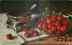 strawberries in glass bowl, silver sugar box left, two glasses behind, one on its side