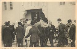 ROYAL VISIT TO FIJI PAVILION, WEMBLEY back view of Royal party entering pavilion