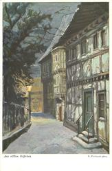 snow scene, alley with houses right, fence & tree left, street light left