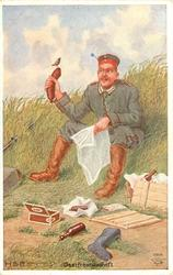 GASTFREUNDSCHAFT German soldier relaxes sitting on grassy bank, newspaper in one hand, sausage in the other, bird perched on sausage, cigars & drink front