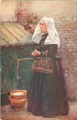 SERIES HOLLAND. BAUERIN DORDRECHTE Dutch woman stands facing left, basket on arm, white head scarf