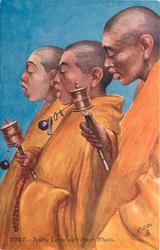 YELLOW LAMAS WITH PRAYER WHEELS