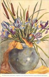purple/yellow iris & bullrushes in blue vase, yellow trailer partly around